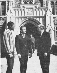 Student Herman Thomas (B.D. '66, Th.M. '69 ), an unidentified man, and Divinity School Dean Robert Cushman in 1965.