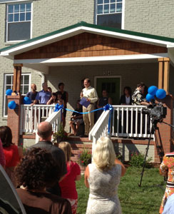 Floding speaks at the ribbon-cutting ceremony Sunday, Sept. 22.