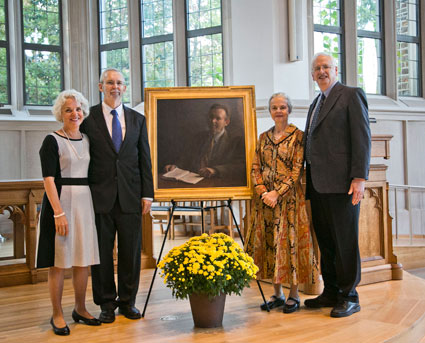 Judy and Richard Hays pose with Davis and Maddox next to the portrait.