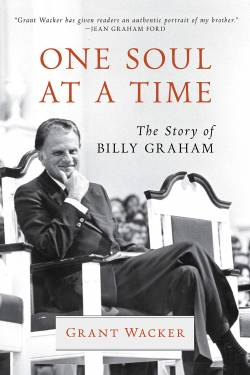 Rev. Billy Graham poses in a chair on cover of Grant Wacker biography.