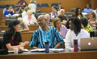 Institute participants engage each other during plenary