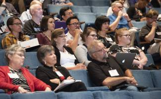 Attendees listening to speaker at 2018 event.