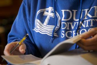 close-up of student studying wearing Duke Divinity sweatshirt