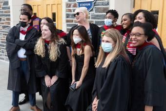 Graduates pose in front of Cameron Indoor Stadium