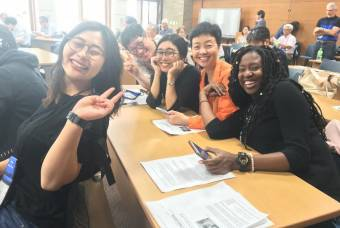 students pose at table