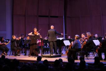 An orchestra is conducted by Jeremy Begbie