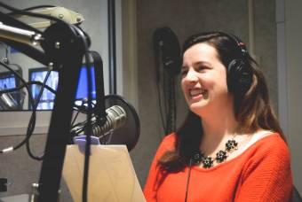Kate Bowler in recording studio smiling