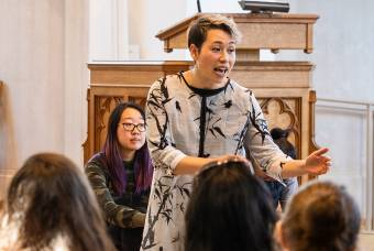 A leader of the Asian Theology Group speaks during worship in Goodson Chapel