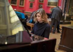 Pianist Cordelia Williams performs music written by Jeremy Begbie during an event  at King's College exploring how faith has responded to modernity.