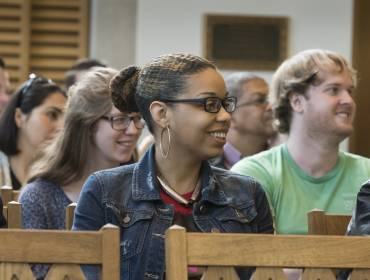 Students smile during senior cross service