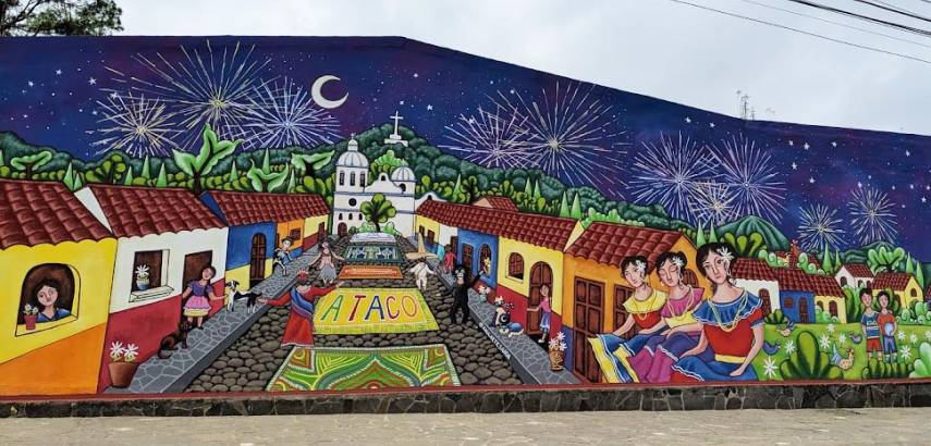 A mural shows a town and townspeople